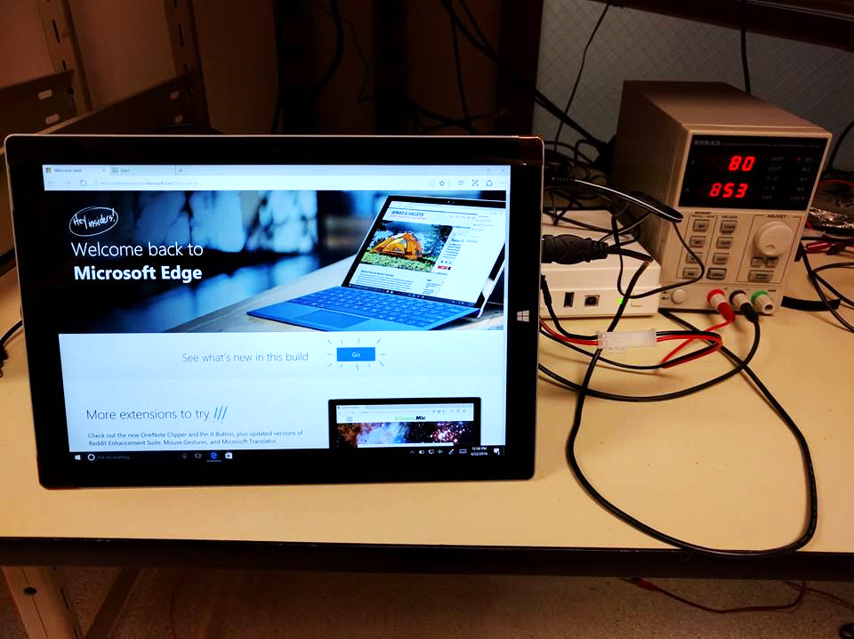 Photo of a Surface Pro 3 attached to instantaneous power consumption equipment.